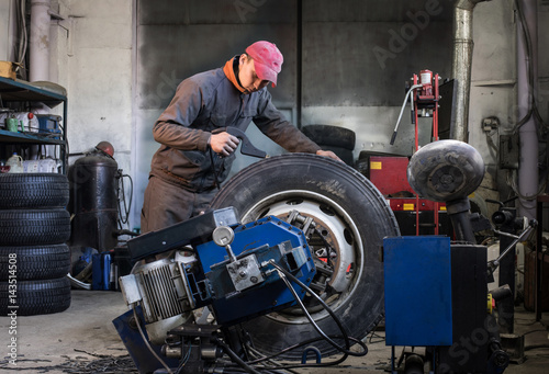 mechanic is repairing truck wheels