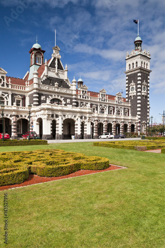 Dunedin Railway Station, now only used by the Taieri Gorge preservation railway, seen across the gardens in Anzac Square Poster
