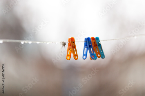 A Colorful clothespins on the clothesline outdoors Poster