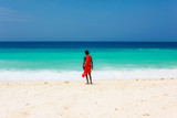 masai on a beach and blue sea on the background