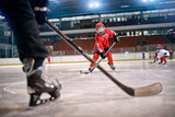 Fototapety Hockey match at rink player in action .