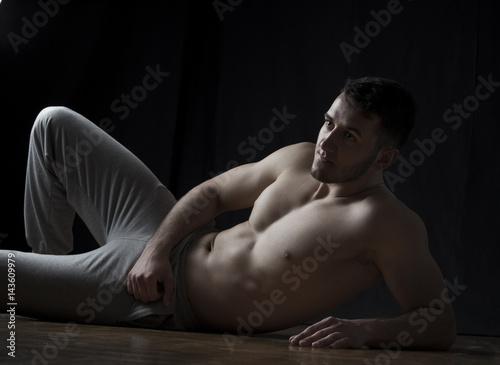 Strong man lying on floor