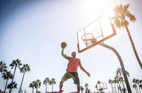 Poster Basketball slam dunk on a californian court
