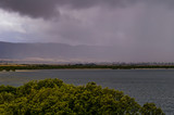 Storm front moving over Port Pirie bay bringing rain and rainbows to the Flinders Ranges