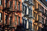 Colorful Soho building facades with painted fire escapes. Manhattan, New York City - 143683167