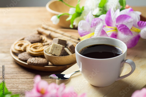 Poster black coffee in white cup with cookie and dessert