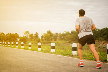 Healthy lifestyle concept, Fitness sport man running in sunset nature.