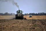 Tractors prepare the area for planting sugar beets using strips for fine grinding ground