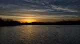 Sunrise over a lake near the Des Moines river