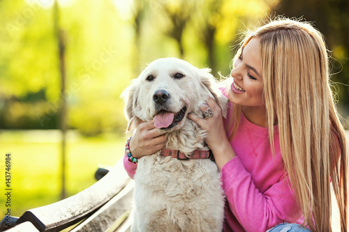 Young Woman in Park With Dog