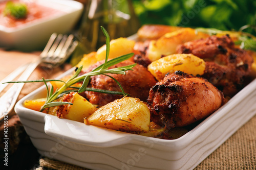 Chicken meat baked with potatoes and spices.