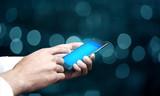 eribusinessman hand smart phone with bokeh background