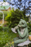 garden sculpture Frog on the background of country house