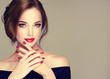 Leinwanddruck Bild - Beautiful model girl with elegant hairstyle . Woman with red lips and nails  . Cosmetics, beauty and manicure on nails