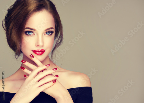 Leinwanddruck Bild Beautiful model girl with elegant hairstyle . Woman with red lips and nails  . Cosmetics, beauty and manicure on nails