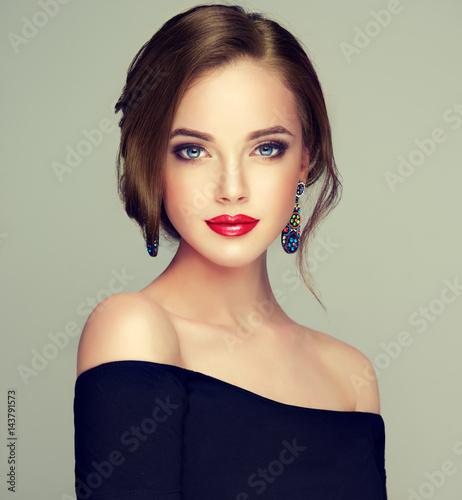 Leinwanddruck Bild Beautiful model girl  with elegant hairstyle . Woman with fashion style makeup