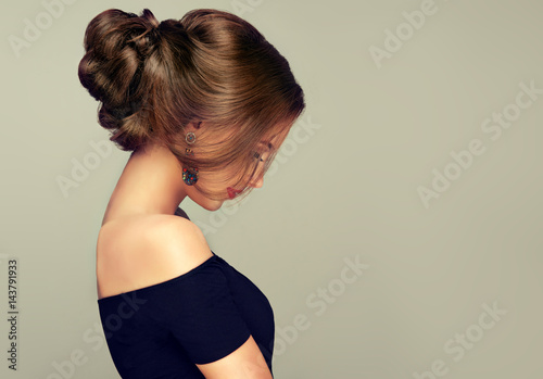 Leinwanddruck Bild Beautiful model girl  with elegant hairstyle . Woman with fashion style makeup