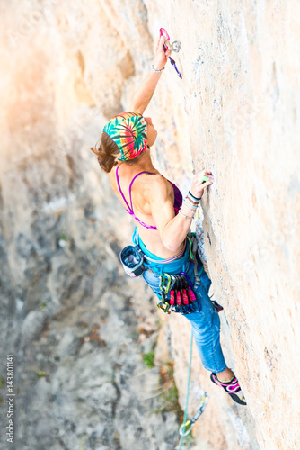 Poster Climber while inserting rope carabiner