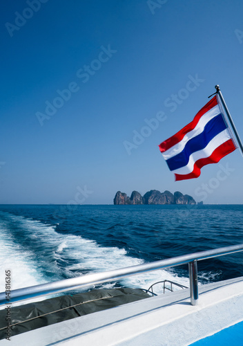 Poster Thai flag on the boat over beautiful sea and summer blue sky background