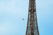 Beautiful Eiffel tower in Paris with a helicopter flying by. Flying over Paris.
