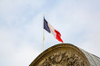 Amazing architecture in Paris, France with French flag on the top of the roof. Nobel symbol of France.