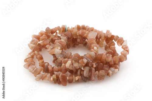 Natural stones, beads made of sunny stone on a white background Poster
