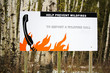 Helping prevent wildfire sign by reminding to call