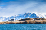 Coastal Icelandic landscape with snowy mountains