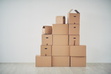 Stack of moving boxes in new house - 143897790
