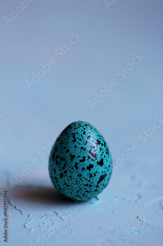 Blue Easter egg on a blue background