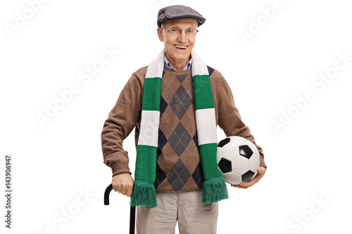 Elderly soccer fan with a scarf and a football
