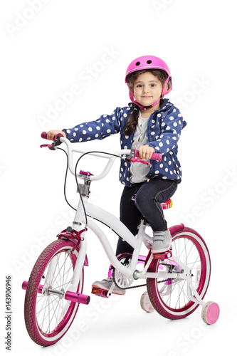 Poster Cute little girl on a bike