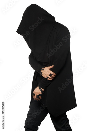 A man in a black gown under a hood Poster