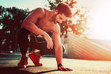 Fototapety Young male jogger athlete training in the city