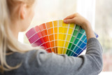 woman designer choosing interior design color from swatch palette - 143943102