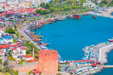 Landscape with marina and Kizil Kule tower in Alanya peninsula, Antalya district, Turkey