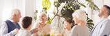 Laughing family eating dinner - 143947908