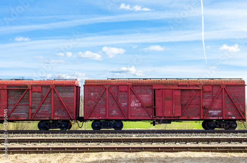 Poster Red train wagons on railroad