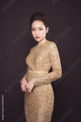 Party. Beautiful sexy asian woman on black background. Poster