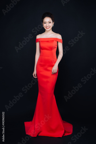 Poster Asian woman with fashion makeup in luxury red dress.