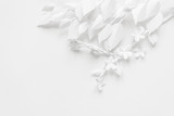 Blooming branch, cut out of white paper on a white background