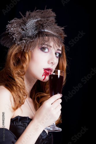 photo of beautiful young woman in vampire character with glass of wine Poster