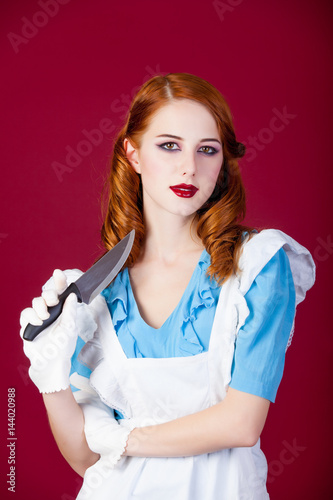 Poster photo of beautiful young woman in Alice murderer character on the wonderful burg