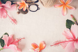 craft with Frangipani, Plumeria, Hibiscus flowers on linen, copy space background, selective focus, toning