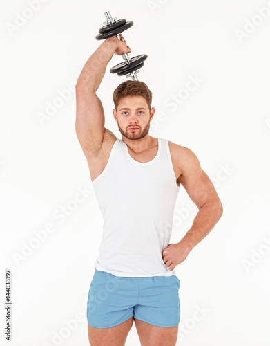 Muscular bodybuilder guy doing exercises with dumbbell isolated on white backgro Poster