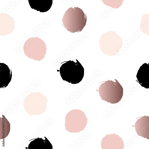 Tapeta Seamless pattern with polka dots of rose gold, pink and black.