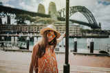Woman posing in Sydney city with Harbour Bridge in the background
