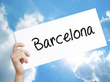 Barcelona Sign on white paper. Man Hand Holding Paper with text. Isolated on sky background