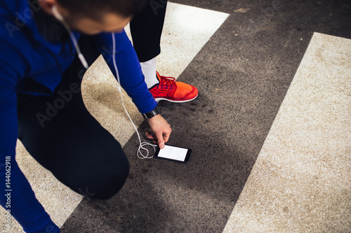 Juliste Checking time for a workout
