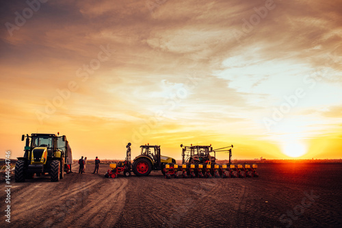Agricultural mechanization on sunset Obraz na płótnie